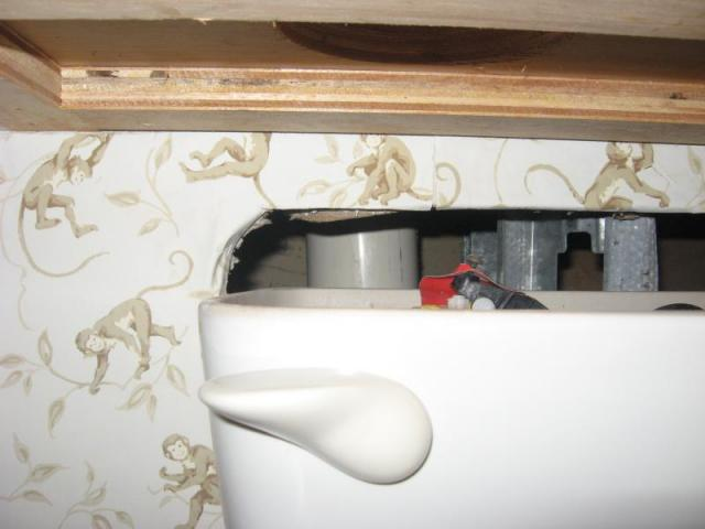 Space saving recessed toilet